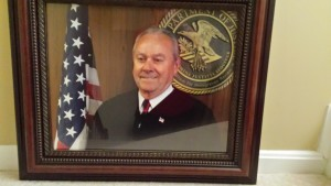 A photo of the official photo of Judge John F. Gossart, Jr. (it's the best we could do!).